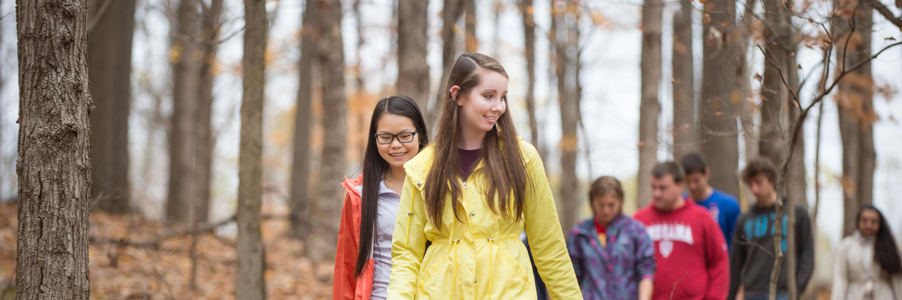 Class of students walking through the woods