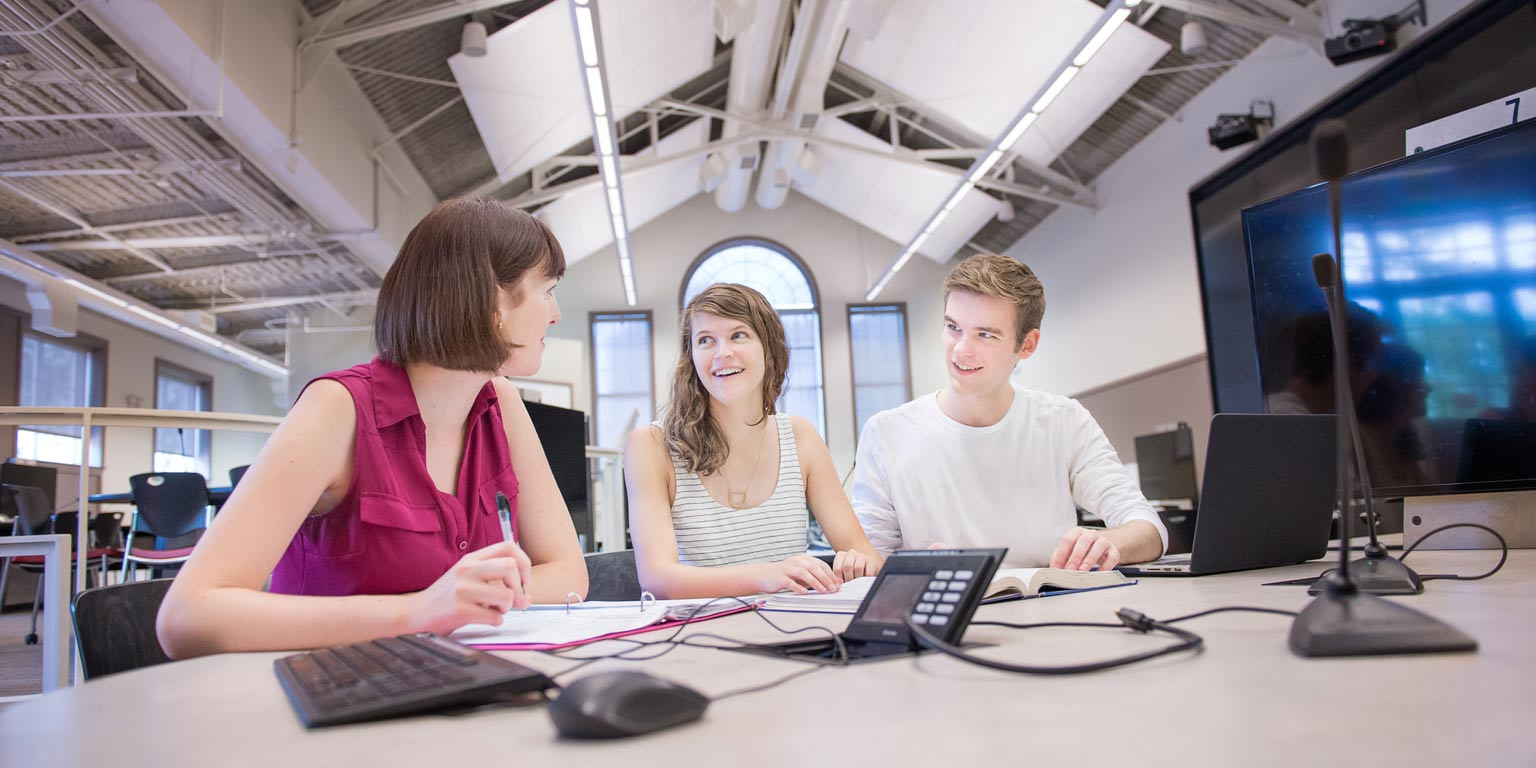 Three students working with classroom technology